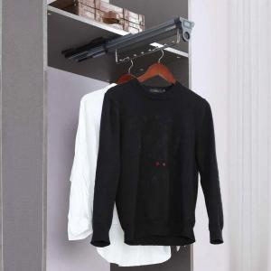 Top mounted clothes holder